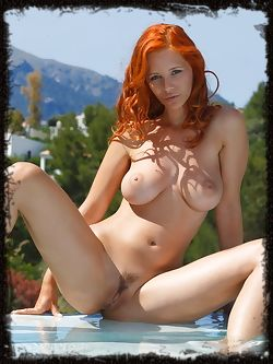 Ariel soaks up the warm morning sun as she bares her voluptuous body, with large, cuppable breasts, meaty ass, and long sexy legs.