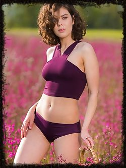 Dakota A bares her gorgeous body as she sensually poses among the flowery field.