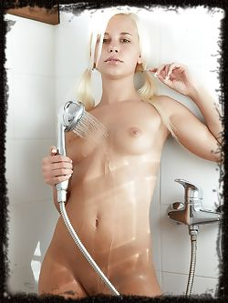 Dido is a petite little wonder model who is naked and in the shower showing her tight round ass.