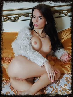 Alluring Debora A flaunts her sexy, tight body with delectable pussy as she poses on the bed.