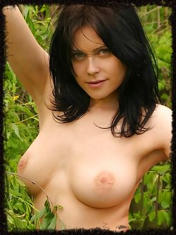 Bonya has blue eyes and big dark hair, she has good sized breasts and big puffy nipples, this set is outdoors.