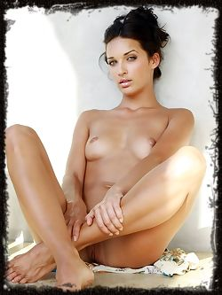 Olga is a big blue eyed naked girl, she so precious you will want to eat her all up, and down and every which way.