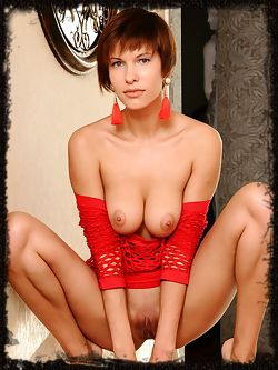 Suzanna A flaunts her red-fishnet dress as she bares her sweet pussy on the sofa.