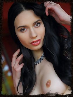 With long black hair, piercing gaze, teasing smile, and a hot body with exquisite assets, a naked Dita V is a sight to behold